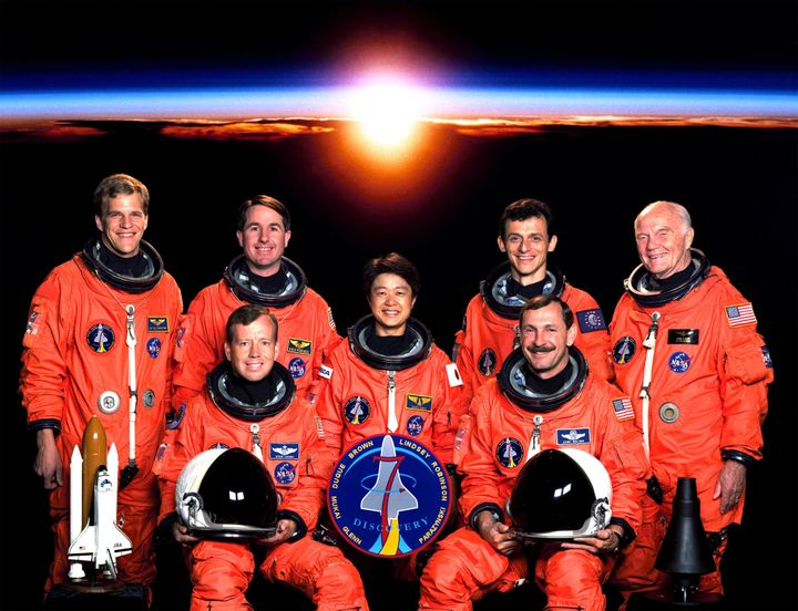 Sen. Glenn (far right), who is classified as a payload specialist, poses with the rest of the crew of his 1998 space shuttle