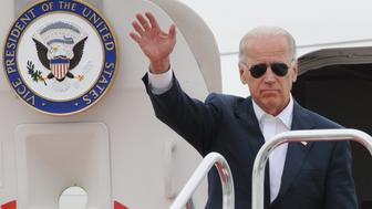 US Vice President Joe Biden waves as he arrives at Sendai airport in Natori, Miyagi prefecture on August 23, 2011 nearly six months after the March 11 earthquake and tsunami. Biden praised Japan's courage and resolve as he visited its tsunami-shattered coast, where US forces helped with a large-scale relief effort.    AFP PHOTO / KAZUHIRO NOGI (Photo credit should read KAZUHIRO NOGI/AFP/Getty Images)