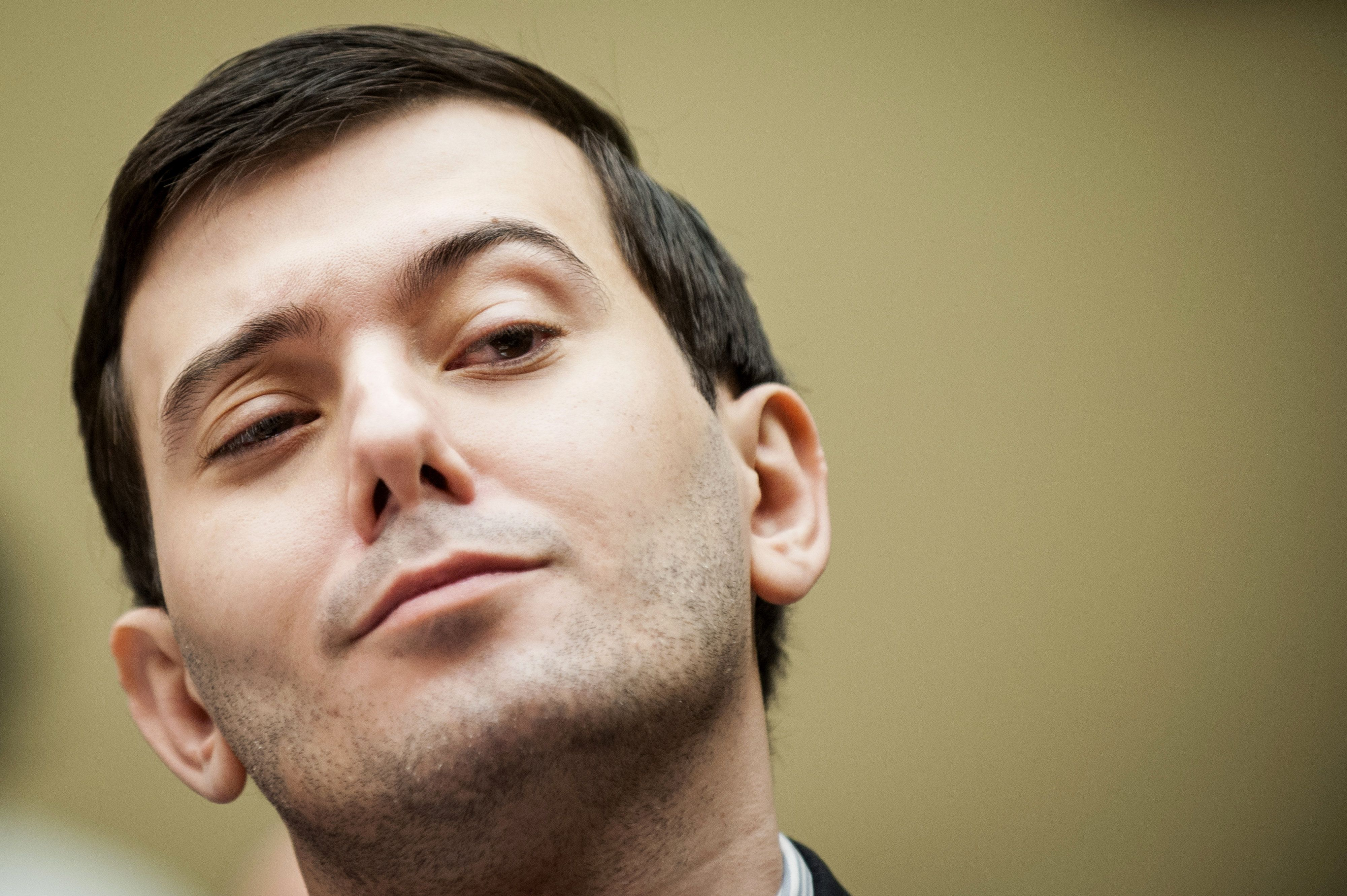 """Embattled pharmaceutical entrepreneurMartin Shkreli shows off his """"Poo Steel"""" poseduring a hearing of the House C"""