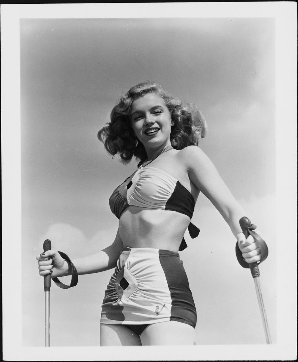 Norma Jeane Baker, future film star Marilyn Monroe, tries her hand at sand skiing, circa 1943.