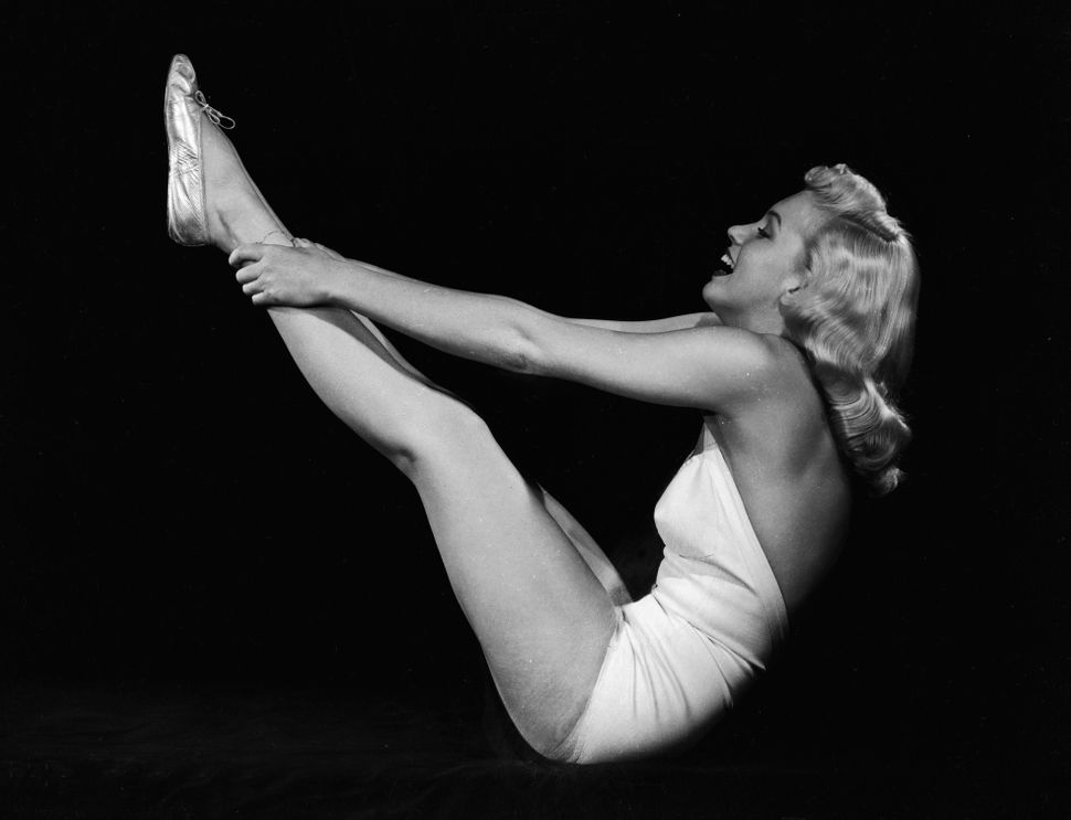 Marilyn Monroe raises her legs in the air and assumes a yogic exercise position, circa 1948.