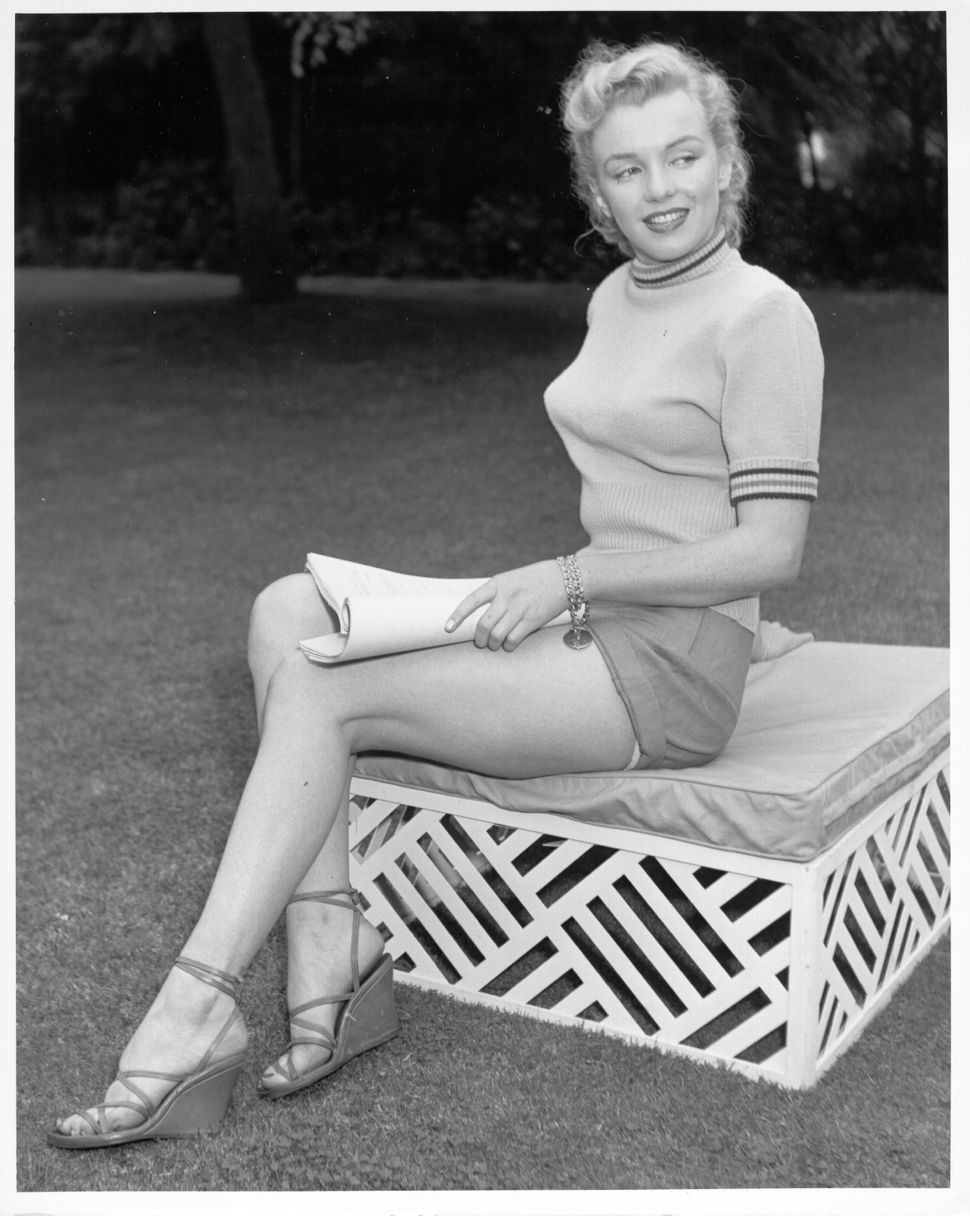 Marilyn Monroe photo session at Hollywood agent Johnny Hyde's backyard on May 17, 1950, in Beverly Hills, California.