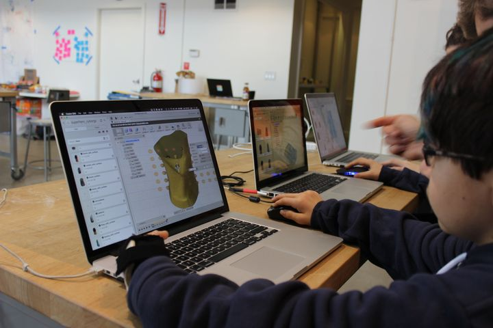 David, 13 years old, learning Autodesk's Fusion360 CAD software to model his wearable prototype.
