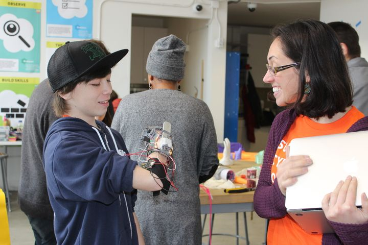 "Kate Ganim with Kieren, 13, who called his project the ""Nubinator,"" a hand with LED lights and aluminum attachmen"