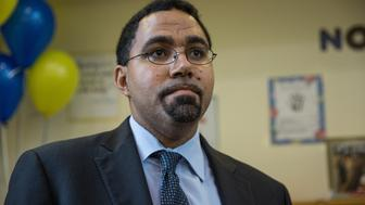 WASHINGTON, DC-OCT7:  Senior Advisor Delegated the Duties of Deputy Secretary of Education, John King, following an awards ceremony at Patterson Elementary School.  (Photo by Evelyn Hockstein/For The Washington Post via Getty Images)