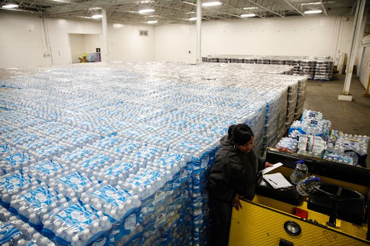 Pallets of bottled water are seen ready for distribution in a warehouse Jan. 21, 2016 in Flint, Michigan.Millions of bo