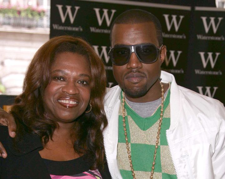 Kanye West poses with his mother Donda prior to signing copies of 'Raising Kanye: Life Lessons From The Mother Of A Hip-Hop S