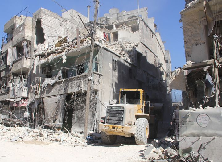 Damaged buildings are seen after Russian airstrikes on Aleppo. Rebel forces in Aleppo have declared a state of emergency in t