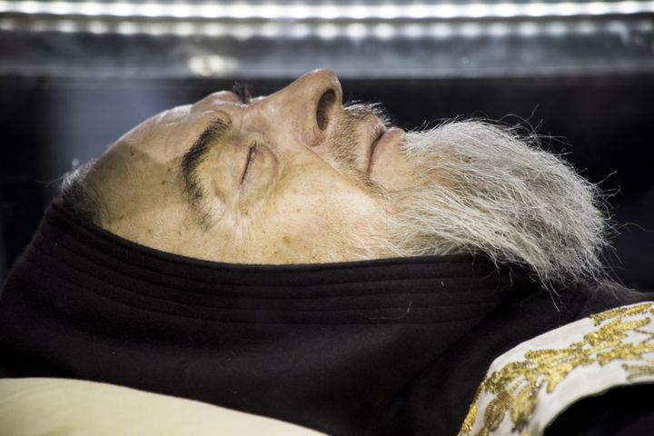 The body of Padre Pio is exposed in a glass case so that all the faithful can admire the saint.