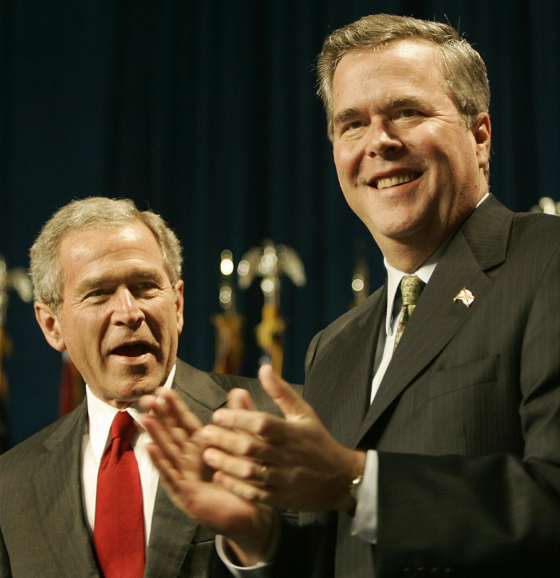 Orlando, UNITED STATES:  US President George W. Bush (L) is introduced by his brother, Florida Governor Jeb Bush (R) before the Republican Party of Florida Dinner 17 February 2006 inside the Walt Disney World's Contemporary Resort in Orlando.    AFP Photo/Paul J. RICHARDS  (Photo credit should read PAUL J.RICHARDS/AFP/Getty Images)