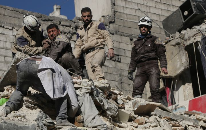 Syria's civil defense team searches for casualties after airstrikes on an opposition-held area of Aleppo on Thursday.Th