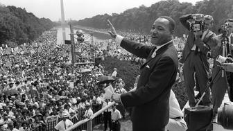 WASHINGTON, UNITED STATES:  (FILES) US civil rights leader Martin Luther King, Jr., waves to supporters from the steps of the Lincoln Memorial 28 August, 1963, on The Mall in Washington, DC, during the 'March on Washington' where King delivered his famous 'I Have a Dream' speech, which is credited with mobilizing supporters of desegregation and prompted the 1964 Civil Rights Act. The US is celebrating in 2004 what would have been King's 75th birthday. King was assassinated on 04 April, 1968, in Memphis, Tennessee.  AFP PHOTO/FILES  (Photo credit should read -/AFP/Getty Images)
