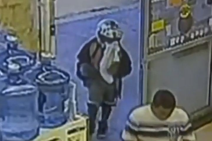 Surveillance video from a grocery store in West Palm Beach, Florida, shows an 8-year-old boy enter before attempting to rob t