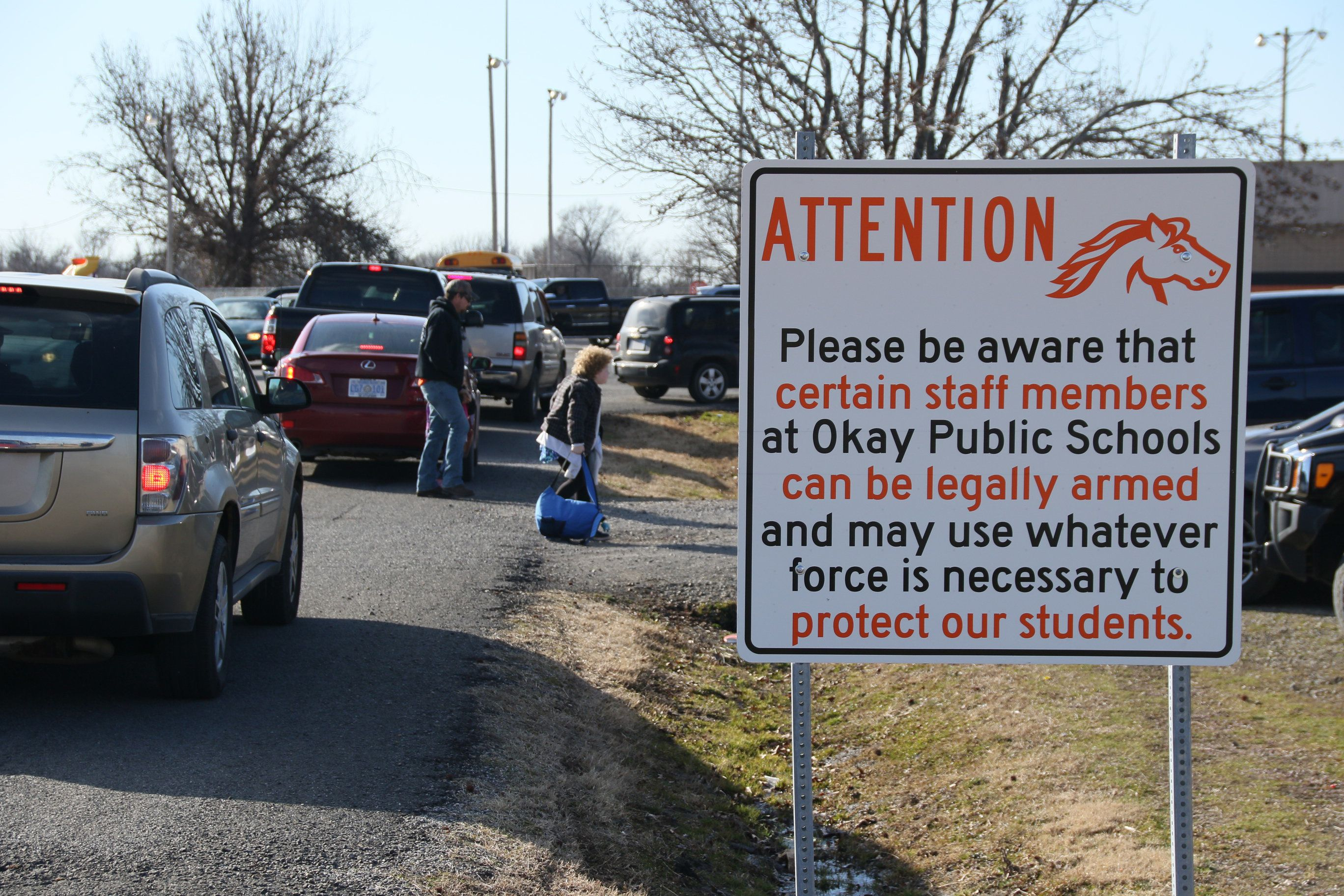 New signs posted on the grounds of Okay Public Schools in Oklahoma warn that staff members may be armed.