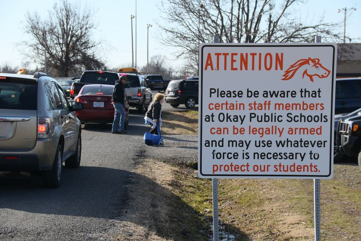 New signs posted on the grounds of Okay Public Schools in Oklahoma warn thatstaff membersmay be armed.