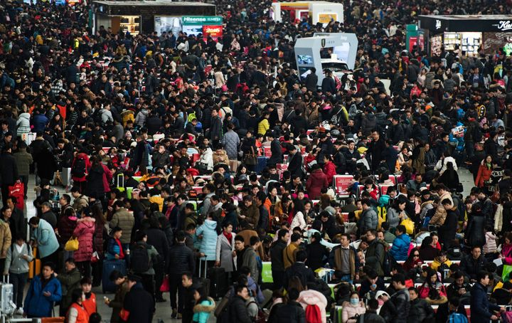 Passengers crowd the Shanghai Hongqiao railway station as they wait to board their trains to head to their hometowns for the