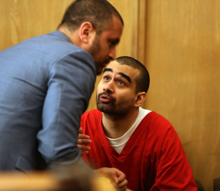 Derek Medina, right, who killed his wife and posted a photo of her body on Facebook, speaks to his attorney, Saam Zangeneh, a