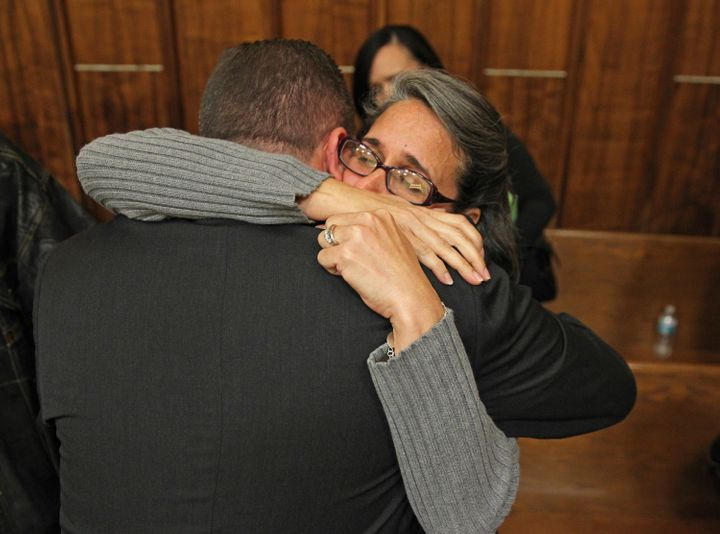 Carolyn Knox, mother of murder victim Jennifer Alfonso, receives a hug from Miami-Dade homocide Det. Jonathan Grossman after