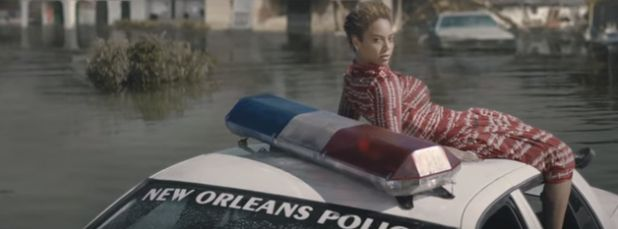 "Beyoncé sits on top of a New Orleans police car in her new video, ""Formation."""