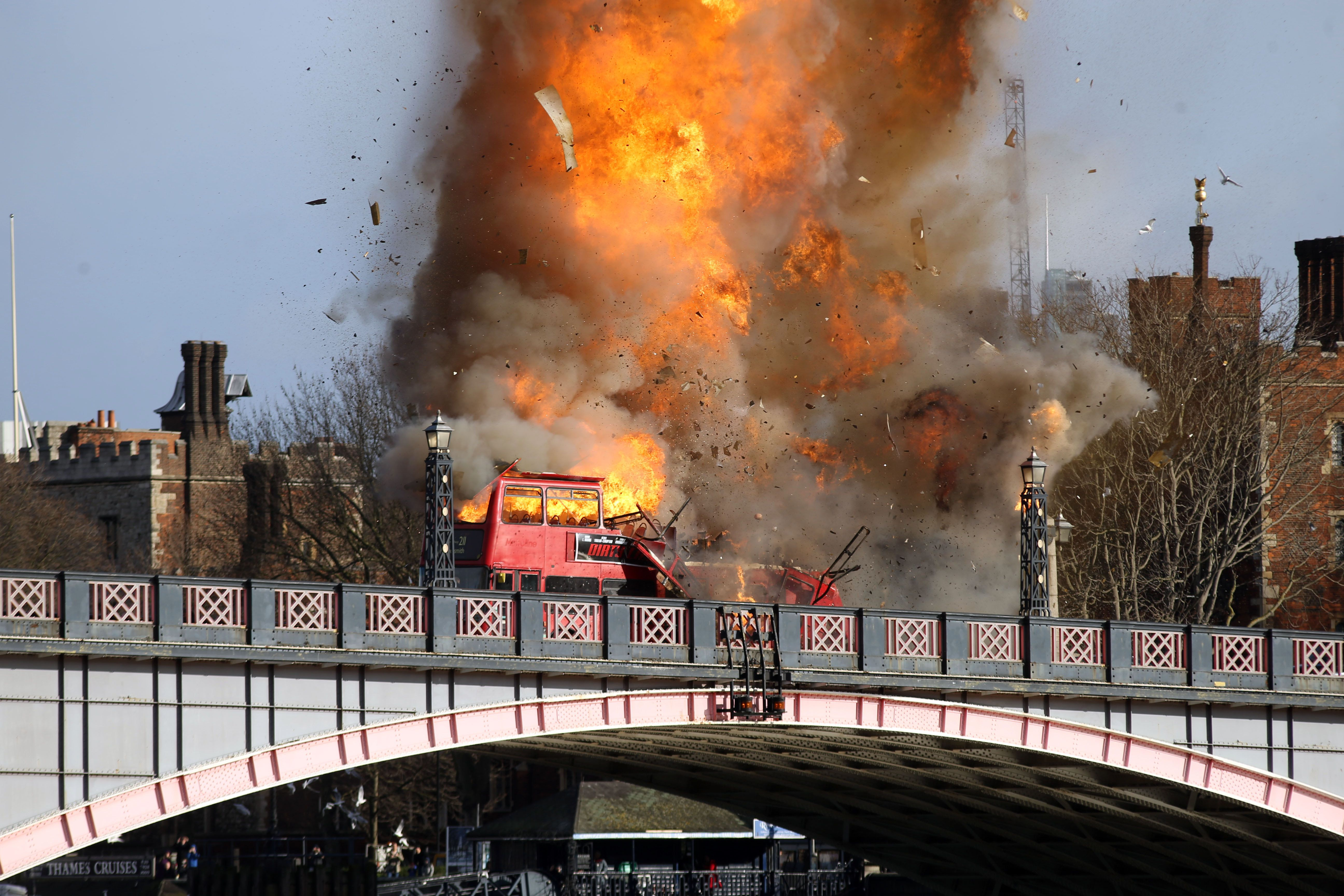 A bus explodes on Lambeth Bridge in London during filming for Jackie Chan's new film The Foreigner.