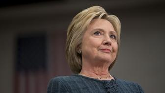 Hillary Clinton, former Secretary of State and 2016 Democratic presidential candidate, listens during her introduction at a campaign event in Concord, New Hampshire, U.S., on Saturday, Feb. 6, 2016. Trailing Bernie Sanders in the Democratic contest by 20 percentage points or more in some polls of voters in the state, Clinton recalled that New Hampshire gave her a come-from-behind victory in the 2008 primary race and a dramatic boost to her husband, Bill Clinton, in his first run for the presidency in 1992. Photographer: Daniel Acker/Bloomberg via Getty Images