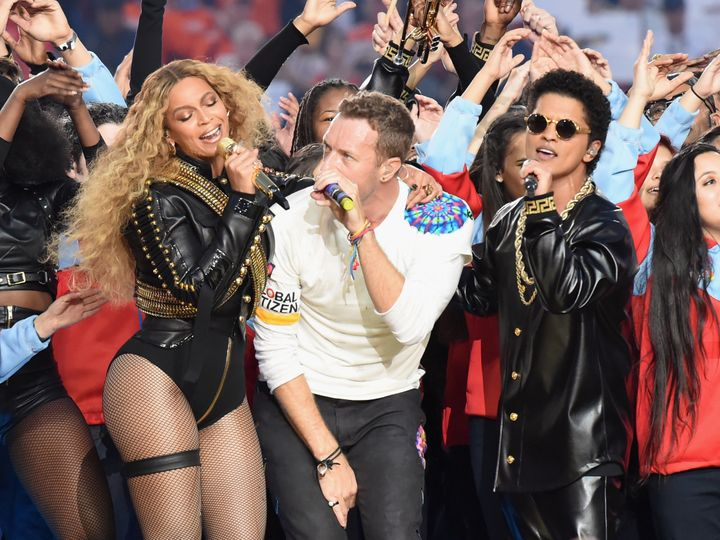 Beyonce, Chris Martin of Coldplay and Bruno Mars perform onstage during the Pepsi Super Bowl 50 Halftime Show at Levi's Stadi