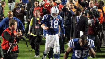 MIAMI GARDENS, FL - FEBRUARY 07:  Peyton Manning #18 of the Indianapolis Colts walks off the field after being defeated by the New Orleans Saints during Super Bowl XLIV on February 7, 2010 at Sun Life Stadium in Miami Gardens, Florida.  (Photo by Jed Jacobsohn/Getty Images)