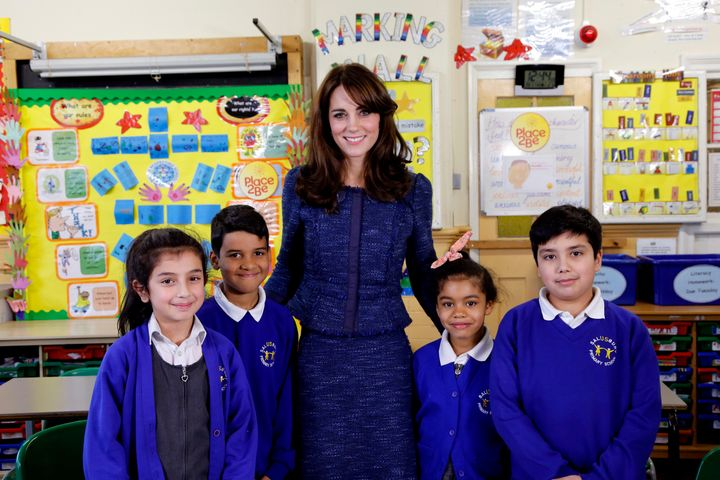 Catherine, Duchess of Cambridge poses for a photo with (L-R) Nimra, 10, Ryan, 10, Bailey-Rae, 7, and Connor, 11, from Salusbury Primary School in Queen's Park, London, during filming of a video message for Children's Mental Health week.