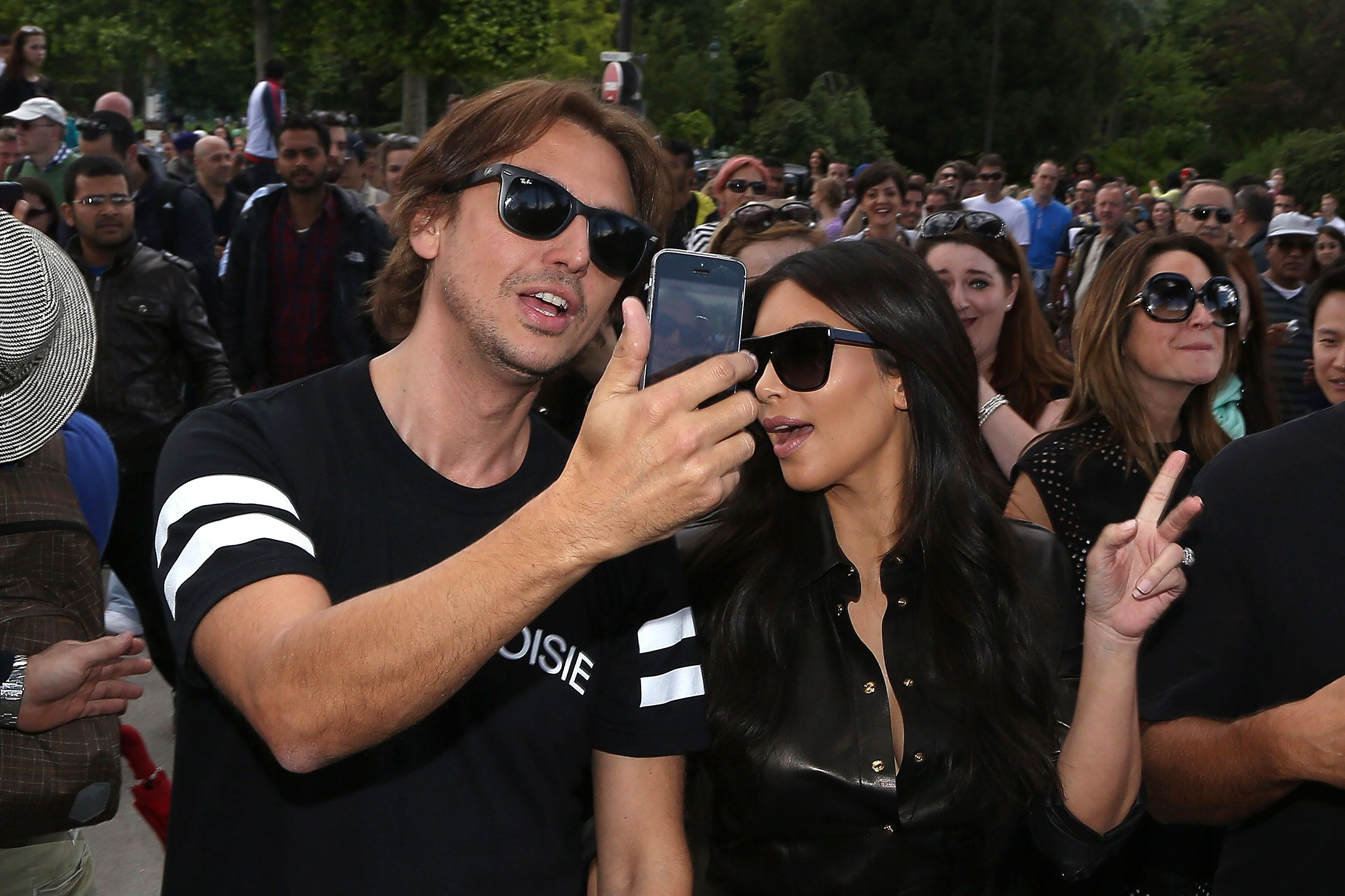 PARIS, FRANCE - MAY 22:  Kim Kardashian and Jonathan Cheban arrive at the Eiffel tower on May 22, 2014 in Paris, France.  (Photo by Marc Piasecki/GC Images)