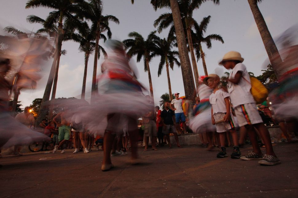 People dance on the streets of Olinda, a coastal city located about 5 miles away from Recife.