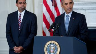 U.S. President Barack Obama speaks during a news conference with John King Jr., senior advisor at the U.S. Department of Education, left, in the State Dining Room of the White House in Washington, D.C., U.S., on Friday, Oct. 2, 2015. Obama announced that Education Secretary Arne Duncan is stepping down in December and will be replaced by Deputy Secretary John B. King Jr. Photographer: Andrew Harrer/Bloomberg via Getty Images