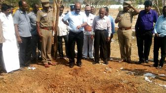Indian authorities inspect the site of a suspected meteorite landing on February 7, 2016 in Vellore district in southern Tamil Nadu state in an impact that killed a bus driver and injured three others on February 6. If proven, it would be the first such death in recorded history. The impact of the object left a large crater in the ground and shattered window panes in a nearby building, killing the driver who was walking past.  AFP PHOTO / AFP / STR        (Photo credit should read STR/AFP/Getty Images)