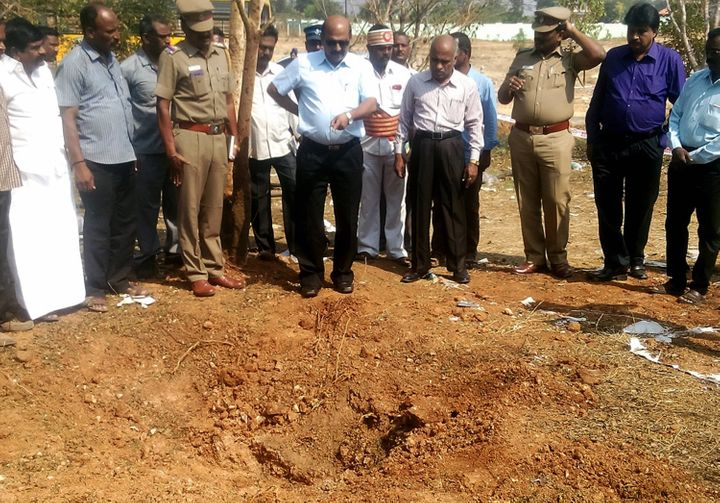 Indian authorities inspect acrater caused by a suspected meteorite that landed on Feb. 7, 2016, killing a bus driver an