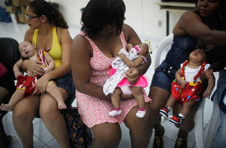 Babies born with microcephaly are dressed in Carnival outfits at a party in a health clinic on February 4, 2016 in Recife, Brazil.