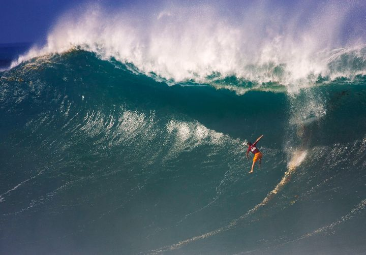 "Daryl ""Flea"" Virotsko wipes out during the Eddie Aikau contest in 2004."