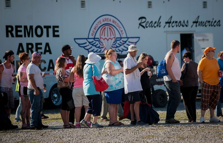 People stand in line for treatment at a Remote Area Medical clinic at the Wise County Fairgrounds in Wise, Virginia
