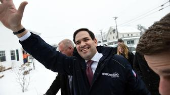 US Republican presidential candidate Marco Rubio (C) arrives at a restaurant for a campaign stop in Goffstown, New Hampshire, on February 8, 2016. US presidential candidates fanned out across snowy New Hampshire seeking to convert undecided voters with just hours to spare before Tuesday's crucial primary. / AFP / Jewel Samad        (Photo credit should read JEWEL SAMAD/AFP/Getty Images)