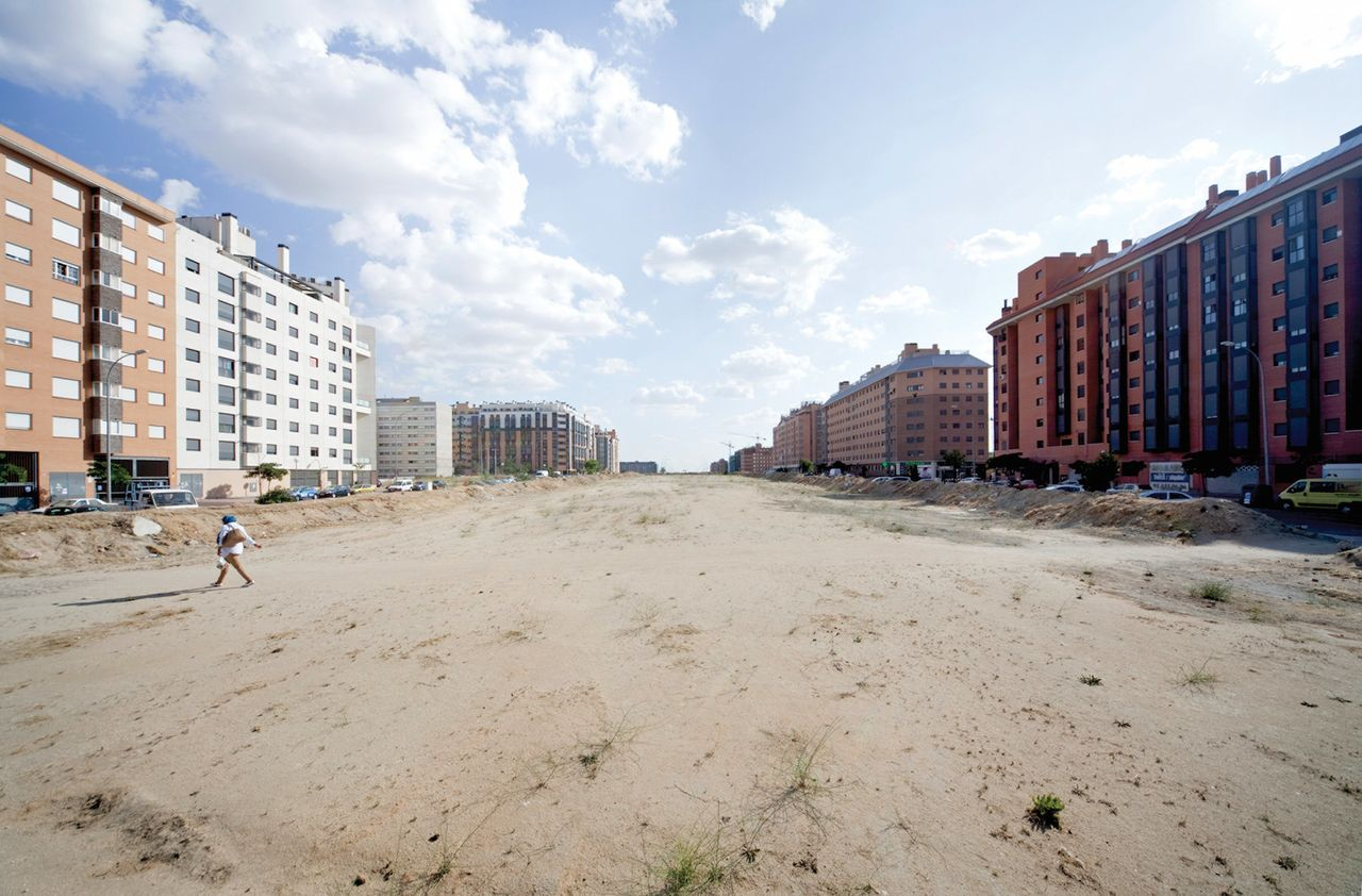 Large and incomplete public spaces throughout the Ensanche de Vallecas development near Madrid, shown in 2014, exacerbates the sense of emptiness and abandonment.