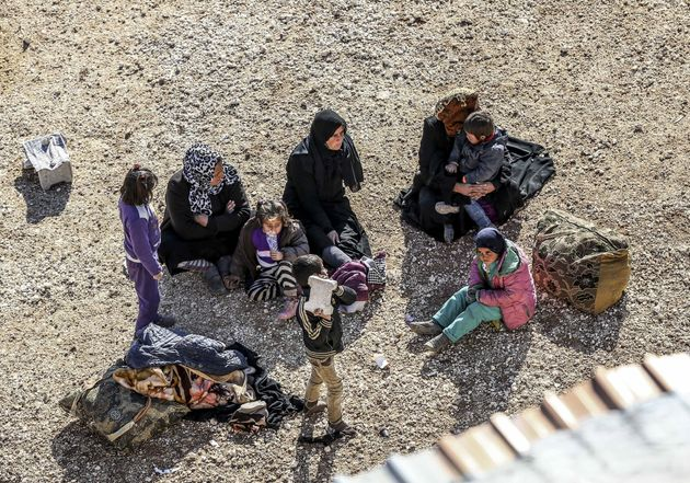 Syrians rest at the Turkish-Syrian border near Aleppo. International powers are due to meet on Thursday...