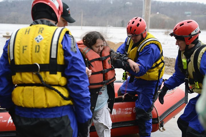 The High Ridge Fire Department performs a water rescue to evacuate stranded residents along the Meremac River on Dec. 30, 201