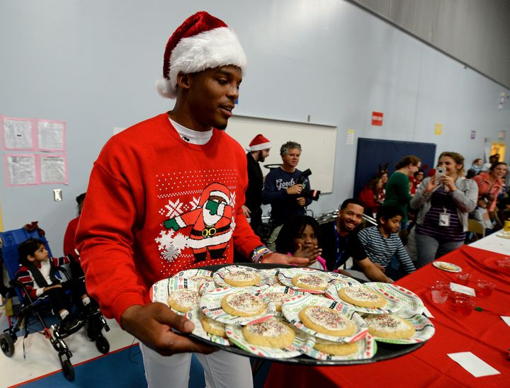 Newton carries a tray of cookies to hand out to Metro School students on Tuesday, Dec. 15, 2015, in Charlotte, North Carolina