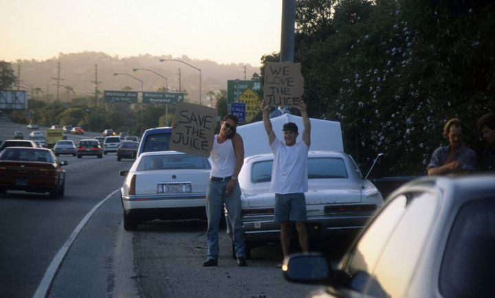 Motorists wave pro-Simpson signs along the 405 freeway.