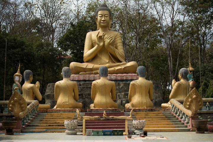 Take another lookat this statue of Buddha in Kampong Thom, Cambodia. The gesture he's making with his hands is called a