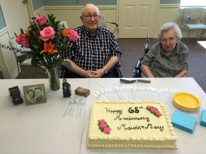The Riddles celebrating their 65th anniversary at their assisted living facility.