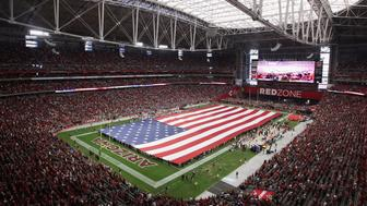 GLENDALE, AZ - NOVEMBER 09:  A giant American flag is displayed on the field prior to the NFL game between the St. Louis Rams and Arizona Cardinals at the University of Phoenix Stadium on November 9, 2014 in Glendale, Arizona.  (Photo by Christian Petersen/Getty Images)
