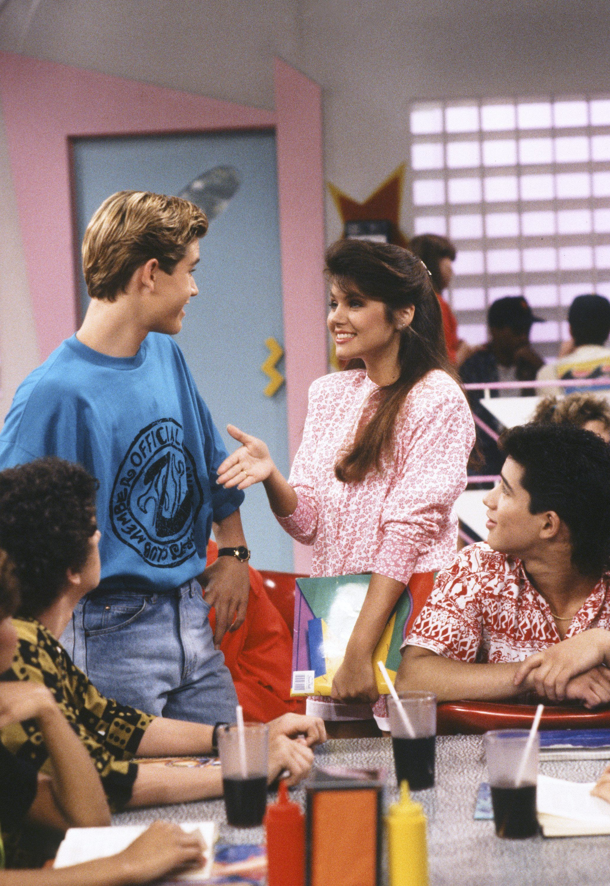 SAVED BY THE BELL -- 'Driver's Education' Episode 4 --  Air Date 09/29/1990 -- Pictured: (l-r) Mark-Paul Gosselaar as Zack Morris,  Tiffani Thiessen as Kelly Kapowski, Mario Lopez as A.C. Slater-- Photo by: Alice S. Hall/NBCU Photo Bank