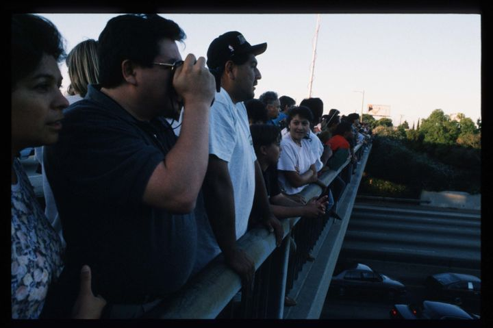 Supporters of O.J. Simpson gather on an overpass along a California freeway.
