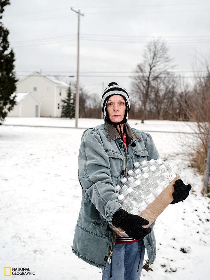 Julie Bennett.<br><br>Bennett is pictured after picking up&nbsp;a pallet of bottled water. Flint's mayor estimates that it co