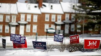 Campaign signs for 2016 Republican presidential candidates Donald Trump, president and chief executive of Trump Organization Inc., Carly Fiorina, former chairman and chief executive officer of Hewlett-Packard Co., and Jeb Bush, former governor of Florida, are displayed in Manchester, New Hampshire, U.S., on Tuesday, Feb. 9, 2016. Voters in New Hampshire took to the polls today in the nation's first primary in the U.S. presidential race. Photographer: Luke Sharrett/Bloomberg via Getty Images