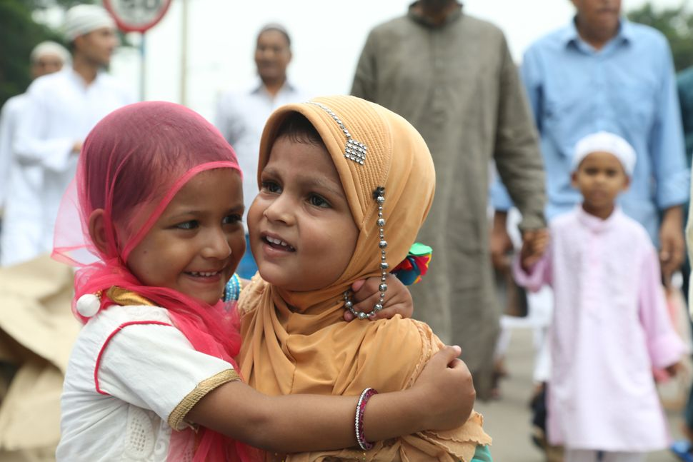 Children and men embracing each other after offering prayer during the 'Eid' Festival on July 18, 2015 in kolkata, India.